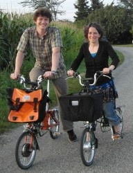 Justin and AnSo on Electric Bromptons
