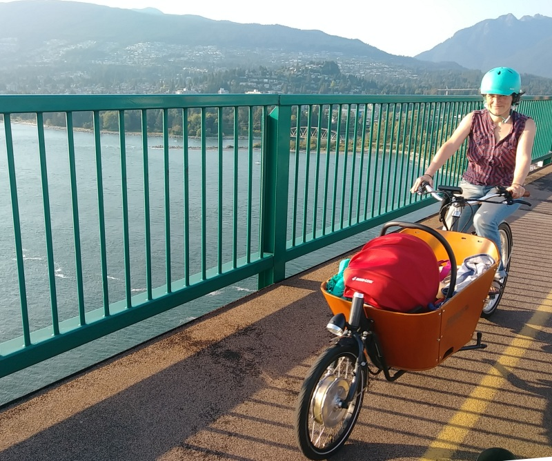 AnSo and Andina over lions gate bridge on a happy cargo bike adventure.