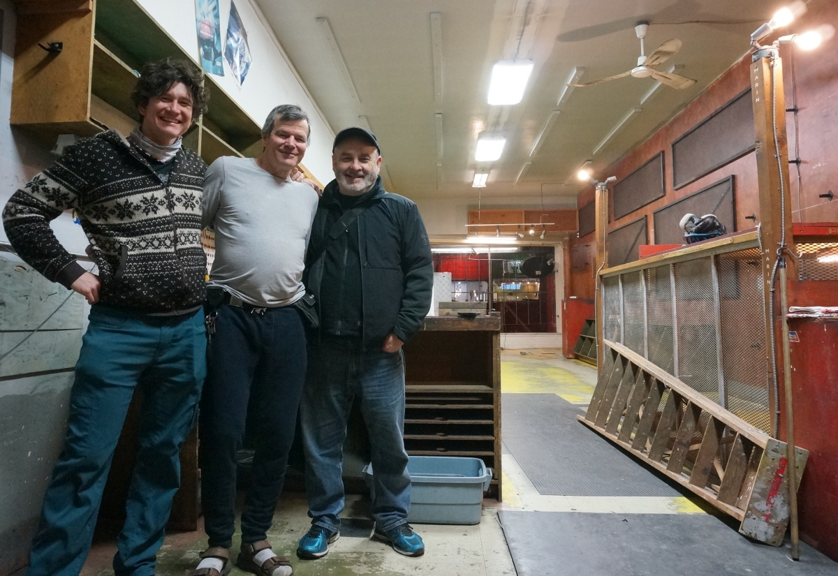 Brock (center) in the cleared out cambie cycles shop. After the party and before an epic ping-pong showdown.