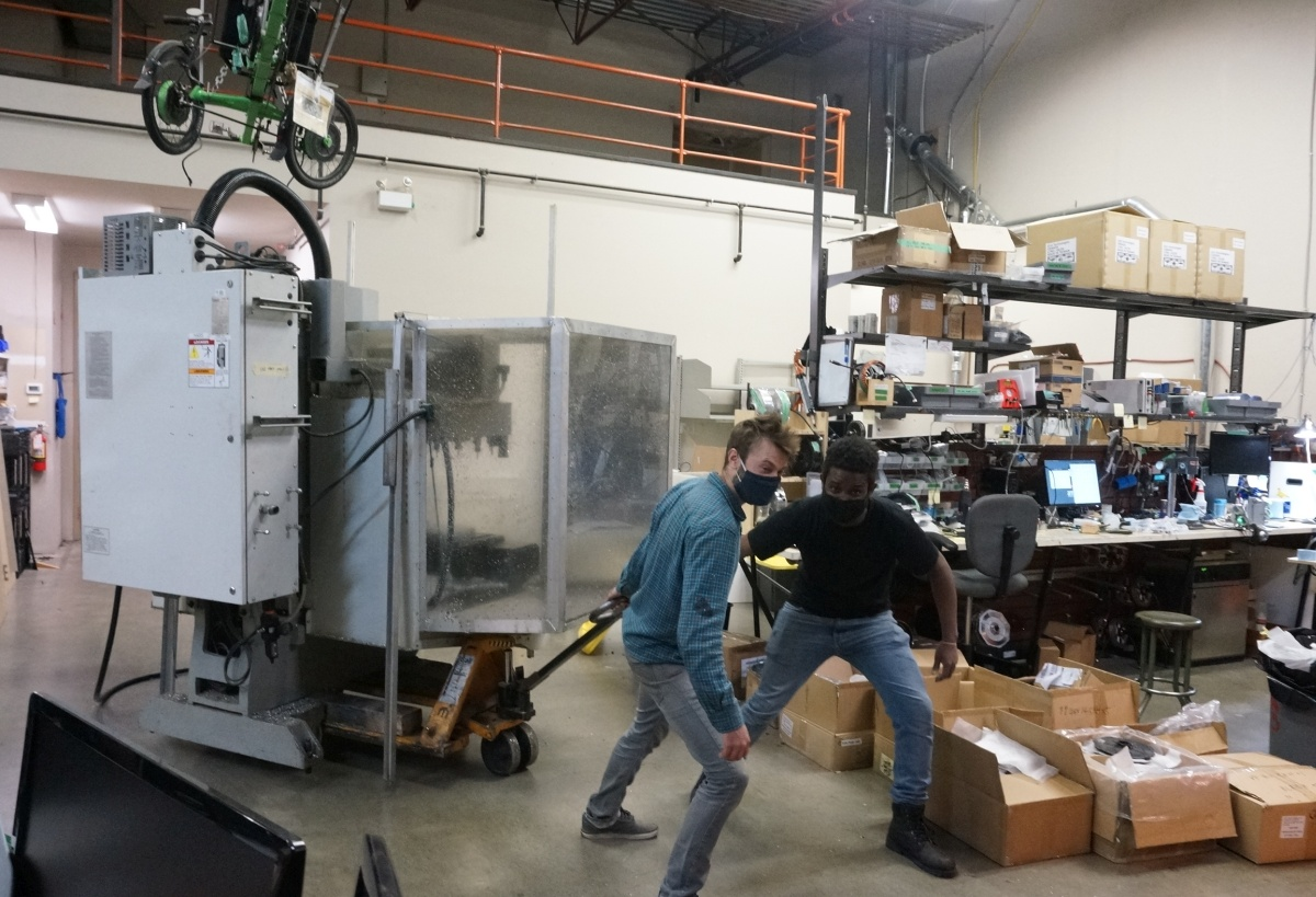 Robbie and Gabriel make short work of of bringing the CNC mill to the front of the shop.